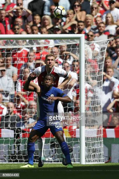 Chelsea's Belgian striker Michy Batshuayi vies with Arsenal's German defender Per Mertesacker during the English FA Community Shield football match...