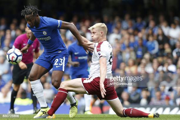 Chelsea's Belgian striker Michy Batshuayi vies with Burnley's English defender Ben Mee during the English Premier League football match between...