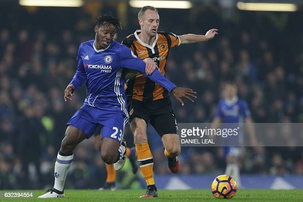 Chelsea's Belgian striker Michy Batshuayi vies with Hull City's Irish midfielder David Meyler during the English Premier League football match...