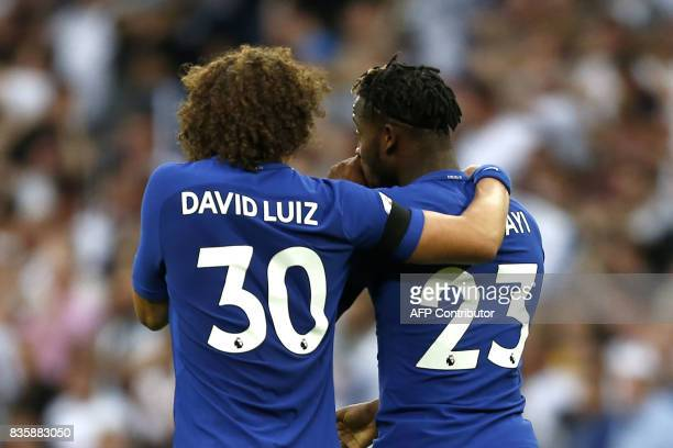 Chelsea's Belgian striker Michy Batshuayi walks with Chelsea's Brazilian defender David Luiz after scoring an own goal during the English Premier...