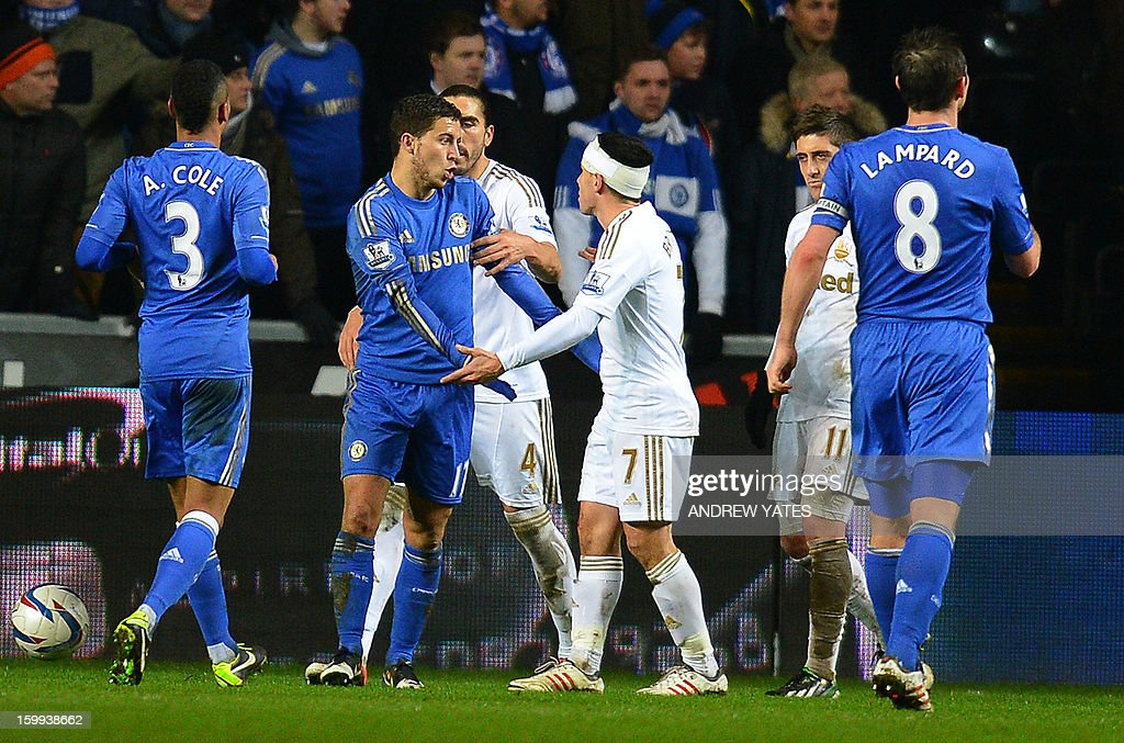 "Chelsea's Belgium midfielder Eden Hazard (2L) is confronted by Swansea City's English midfielder Leon Britton (3R) and Swansea City's Spanish defender Chico Flores (3L) after Hazard was involved in an altercation with a ball boy during the English League Cup semi-final second leg football match between Swansea City and Chelsea at The Liberty stadium in Cardiff, south Wales on January 23, 2013. Hazard was sent off after the incident. AFP PHOTO/ANDREW YATES USE. No use with unauthorized audio, video, data, fixture lists, club/league logos or ""live"" services. Online in-match use limited to 45 images, no video emulation. No use in betting, games or single club/league/player publications."
