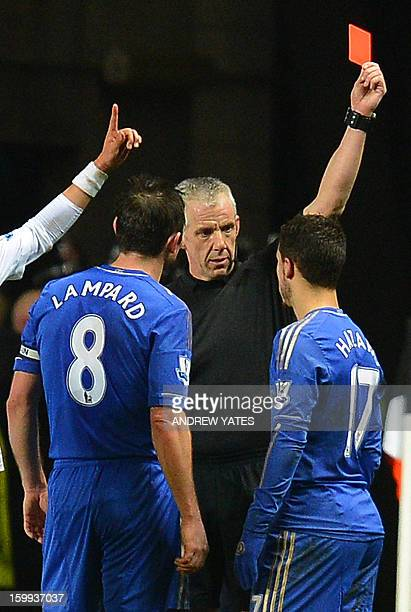 Chelsea's Belgium midfielder Eden Hazard is sent off by referee Chris Foy after an incident involving a ballboy during the English League Cup...