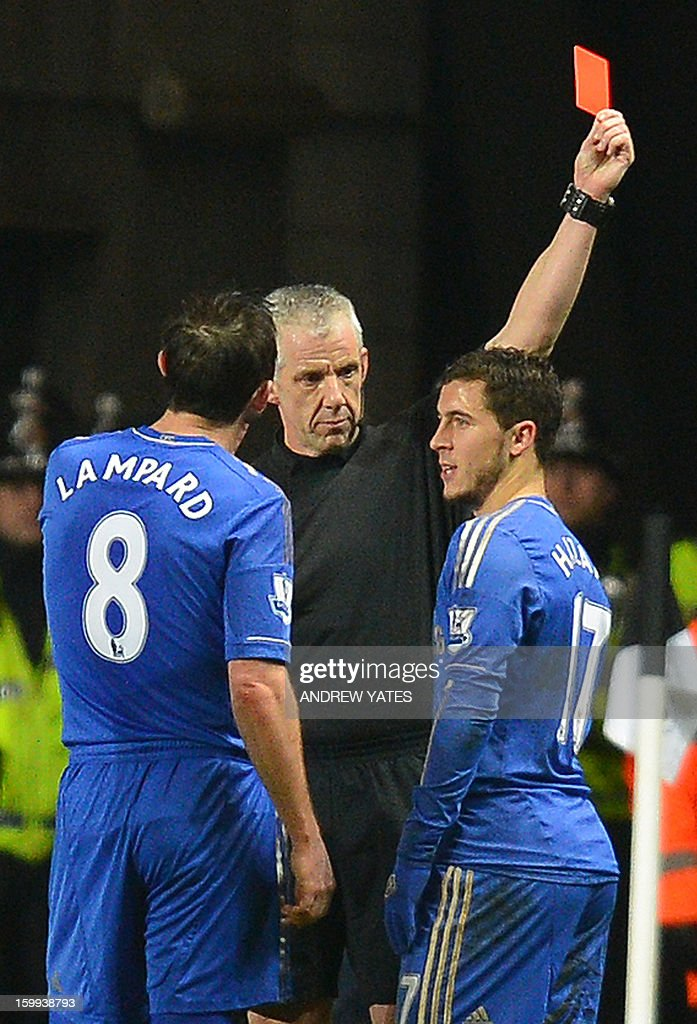 """Chelsea's Belgium midfielder Eden Hazard (R) is sent off by referee Chris Foy (C) after an incident involving a ball boy during the English League Cup semi-final second leg football match between Swansea City and Chelsea at The Liberty stadium in Cardiff, south Wales on January 23, 2013. USE. No use with unauthorized audio, video, data, fixture lists, club/league logos or """"live"""" services. Online in-match use limited to 45 images, no video emulation. No use in betting, games or single club/league/player publications."""