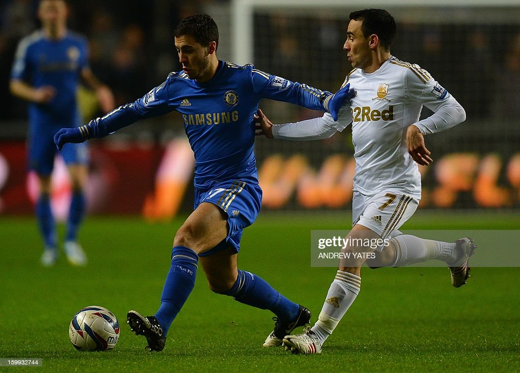 """Chelsea's Belgium midfielder Eden Hazard (L) vies with Swansea City's English midfielder Leon Britton (R) during the English League Cup semi-final second leg football match between Swansea City and Chelsea at The Liberty stadium in Cardiff, south Wales on January 23, 2013. AFP PHOTO/ANDREW YATES USE. No use with unauthorized audio, video, data, fixture lists, club/league logos or """"live"""" services. Online in-match use limited to 45 images, no video emulation. No use in betting, games or single club/league/player publications."""