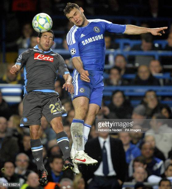 Chelsea's Branislav Ivanovic and Napoli's Ezequiel Lavezzi jump for the ball during the UEFA Champions League match at Stamford Bridge London