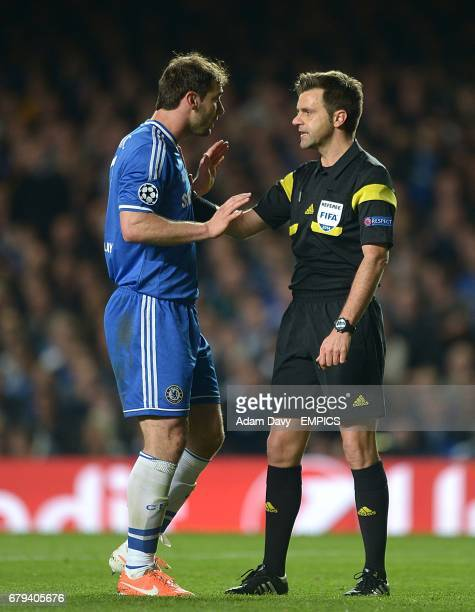 Chelsea's Branislav Ivanovic argues with referee Nicola Rizzoli after Atletico Madrid are awarded a penalty