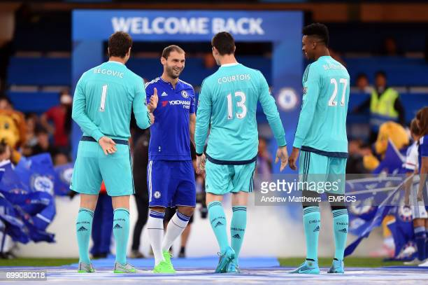 Chelsea's Branislav Ivanovic greets goalkeepers Asmir Begovic Jamal Blackman and Thibaut Courtois as they are introduced to the fans before kick off