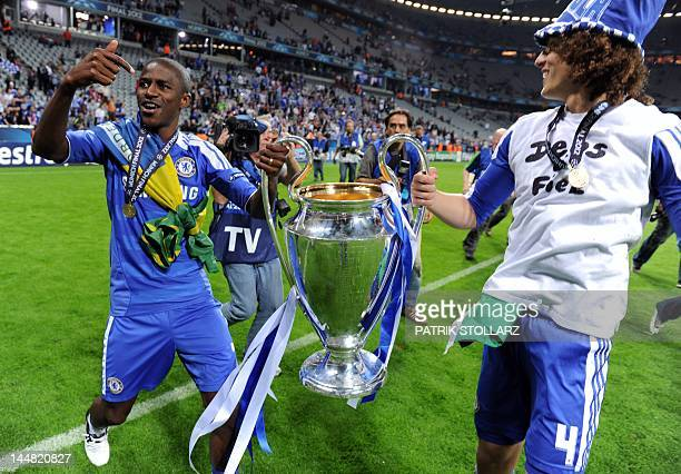 Chelsea's Brazilian defender David Luiz and Brazilian midfielder Ramires celebrate with the trophy after the UEFA Champions League final football...