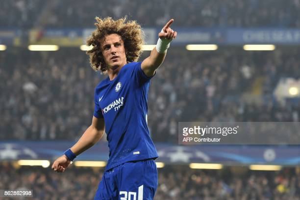 Chelsea's Brazilian defender David Luiz celebrates after scoring during a UEFA Champions league group stage football match between Chelsea and Roma...