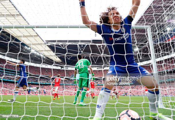 Chelsea's Brazilian defender David Luiz celebrates in the net after Chelsea's Brazilianborn Spanish striker Diego Costa scores their first goal...
