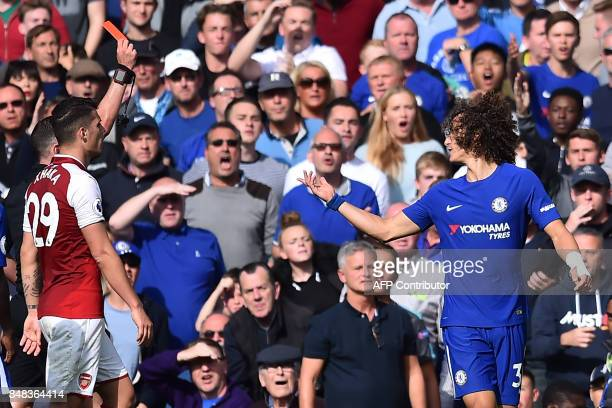 Chelsea's Brazilian defender David Luiz gestures after being shown a red card by English referee Michael Oliver for a dangerous tackle during the...