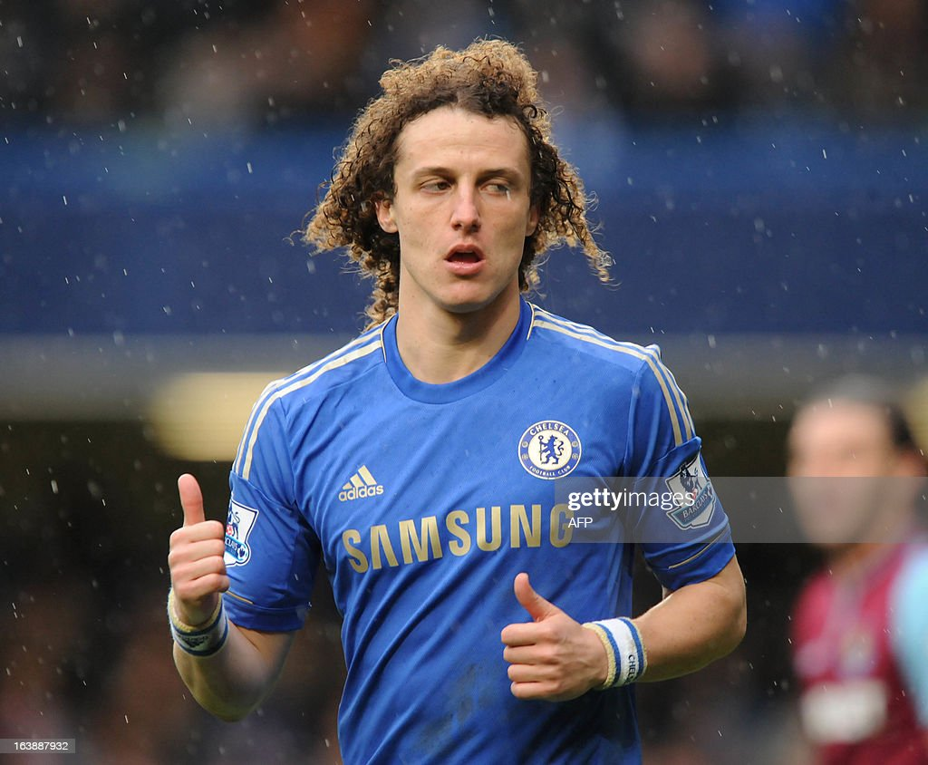"Chelsea's Brazilian defender David Luiz gestures during the English Premier League football match between Chelsea and West Ham United at Stamford Bridge in London on March 17, 2013. USE. No use with unauthorized audio, video, data, fixture lists, club/league logos or ""live"" services. Online in-match use limited to 45 images, no video emulation. No use in betting, games or single club/league/player publications."