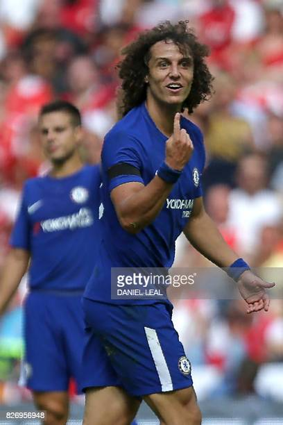 Chelsea's Brazilian defender David Luiz gestures to English referee Robert Madley during the English FA Community Shield football match between...