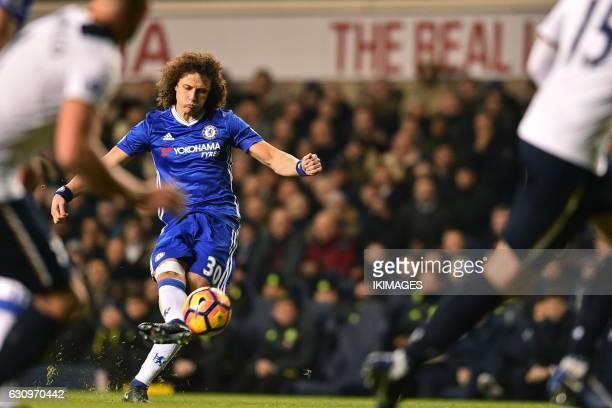 Chelsea's Brazilian defender David Luiz hits this freekick over the bar during the English Premier League football match between Tottenham Hotspur...