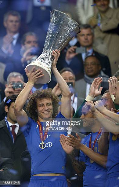 Chelsea's Brazilian defender David Luiz holds up the trophy after the UEFA Europa League final football match between Benfica and Chelsea on May 15...
