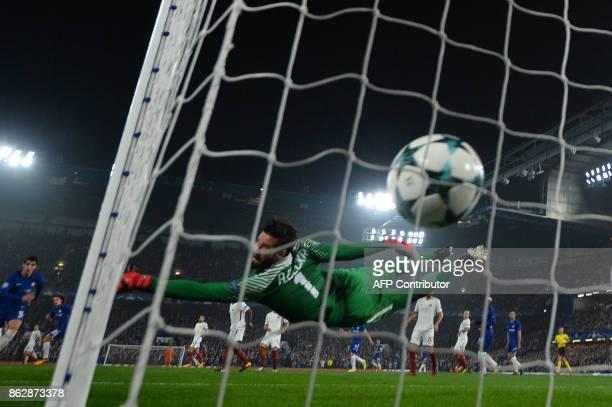 Chelsea's Brazilian defender David Luiz scores past Roma's Brazilian goalkeeper Alisson during a UEFA Champions league group stage football match...