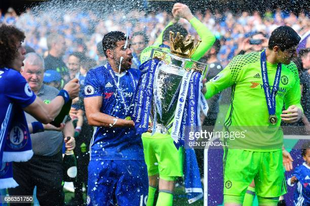 Chelsea's Brazilian defender David Luiz sprays champagne at Chelsea's Brazilianborn Spanish striker Diego Costa and Chelsea's Belgian goalkeeper...