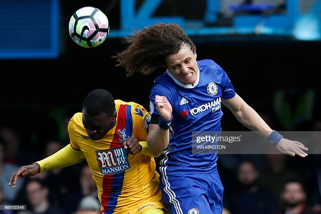 TOPSHOT - Chelsea's Brazilian defender David Luiz (R) vies with Crystal Palace's Zaire-born Belgian striker Christian Benteke during the English Premier League football match between Chelsea and Crystal Palace at Stamford Bridge in London on April 1, 2017. Crystal Palace won the game 2-1. / AFP PHOTO / Ian KINGTON / RESTRICTED TO EDITORIAL USE. No use with unauthorized audio, video, data, fixture lists, club/league logos or 'live' services. Online in-match use limited to 75 images, no video emulation. No use in betting, games or single club/league/player publications. /