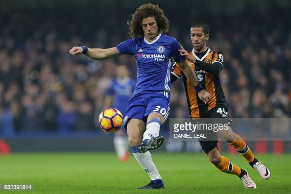 Chelsea's Brazilian defender David Luiz vies with Hull City's Brazilian midfielder Evandro during the English Premier League football match between...