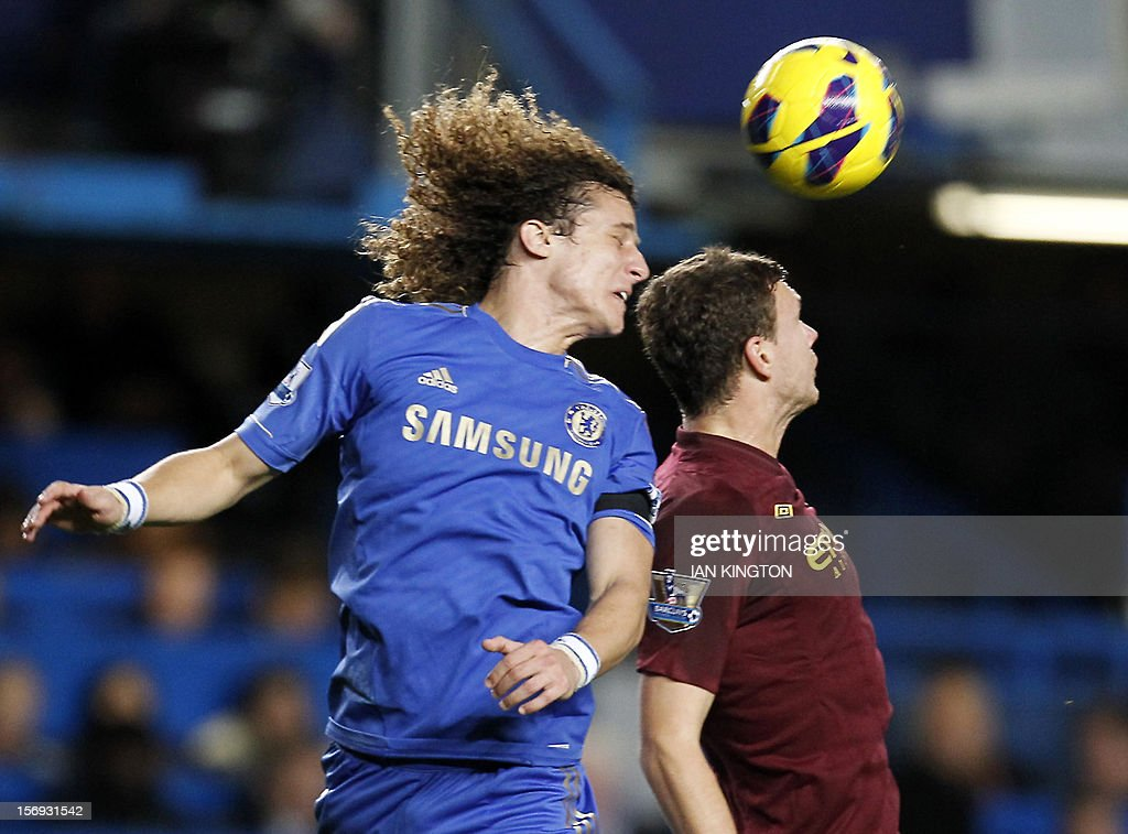 """Chelsea's Brazilian defender David Luiz (L) vies with Manchester City's Bosnian striker Edin Dzeko during the English Premier League football match between Chelsea and Manchester City at Stamford Bridge in London on November 25, 2012. USE. No use with unauthorized audio, video, data, fixture lists, club/league logos or """"live"""" services. Online in-match use limited to 45 images, no video emulation. No use in betting, games or single club/league/player publications"""