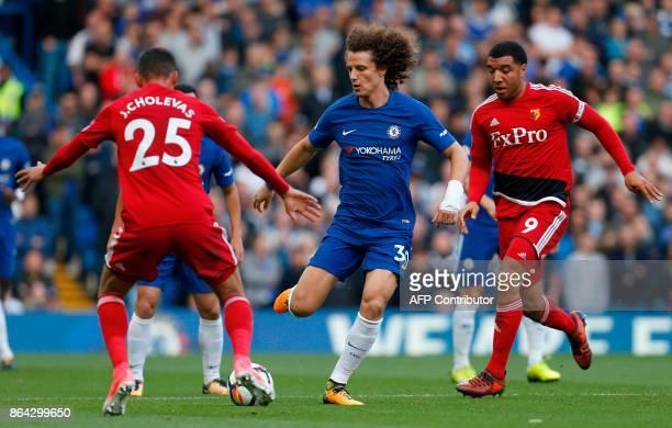 Chelsea's Brazilian defender David Luiz vies with Watford's Germanborn Greek midfielder José Holebas and Watford's English striker Troy Deeney during...