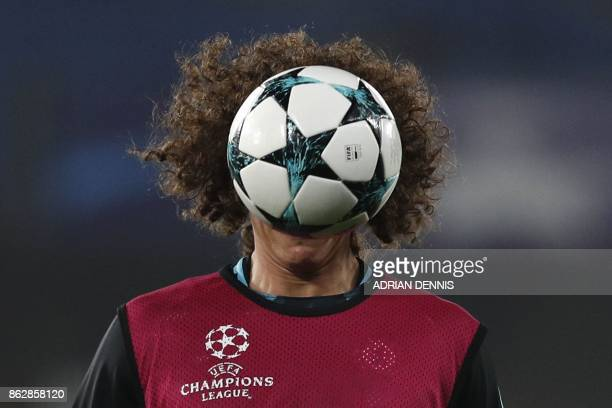 Chelsea's Brazilian defender David Luiz warms up before a UEFA Champions league group stage football match between Chelsea and Roma at Stamford...