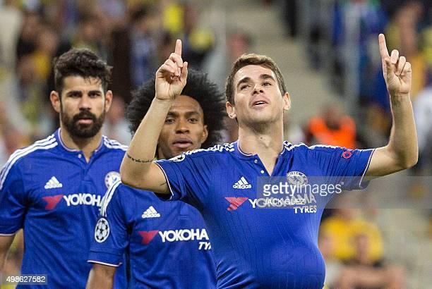 Chelsea's Brazilian midfielder Oscar celebrates after scoring a goal during the UEFA Champions League group G football match between Maccabi Tel Aviv...