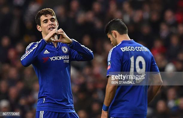 Chelsea's Brazilian midfielder Oscar celebrates after scoring the opening goal of the English FA Cup fourth round football match between MK Dons and...