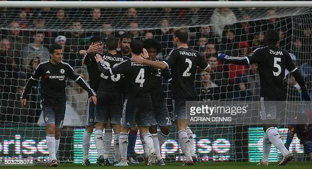Chelsea's Brazilian midfielder Oscar celebrates scoring his team's first goal with Chelsea's Brazilianborn Spanish striker Diego Costa and teammates...