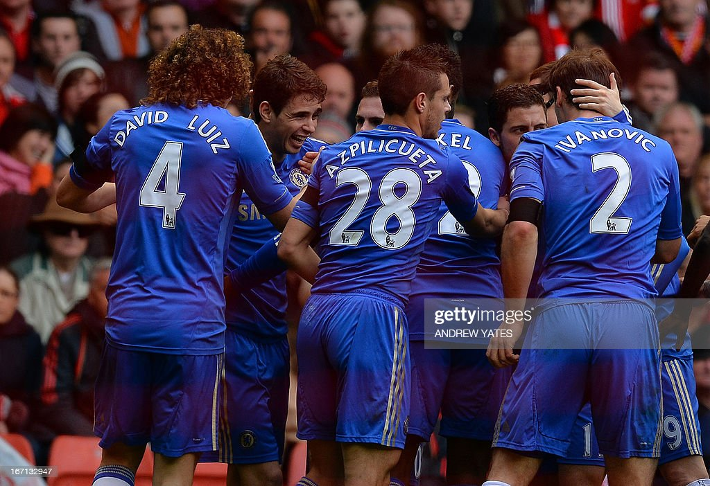 "Chelsea's Brazilian midfielder Oscar (2nd L) celebrates scoring the opening goal with teammates during the English Premier League football match between Liverpool and Chelsea at the Anfield stadium in Liverpool, northwest England, on April 21, 2013. USE. No use with unauthorized audio, video, data, fixture lists, club/league logos or ""live"" services. Online in-match use limited to 45 images, no video emulation. No use in betting, games or single club/league/player publications."