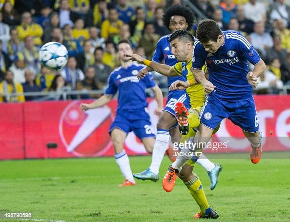 Chelsea's Brazilian midfielder Oscar scores during the UEFA Champions League group G football match between Maccabi Tel Aviv and Chelsea at the Sammy...