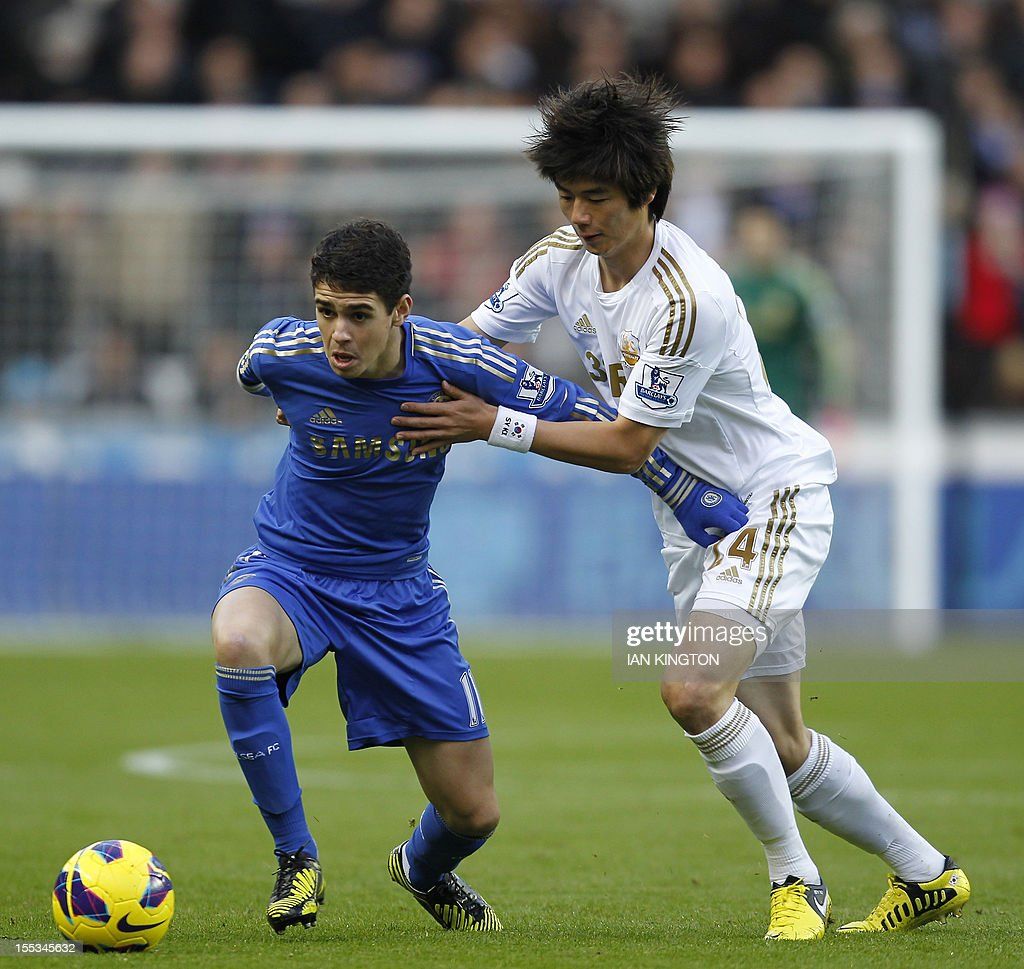 "Chelsea's Brazilian midfielder Oscar (L) vies with Swansea City's South Korean midfielder Ki Sung-Yueng (R) during the English Premier League football match between Swansea City and Chelsea at Liberty Stadium in Swansea, South Wales on November 3, 2012. AFP PHOTO/IAN KINGTON USE. No use with unauthorized audio, video, data, fixture lists, club/league logos or ""live"" services. Online in-match use limited to 45 images, no video emulation. No use in betting, games or single club/league/player publications."