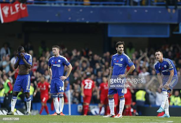Chelsea's Brazilian midfielder Ramires Chelsea's English defender Gary Cahill Chelsea's Spanish midfielder Cesc Fabregas and Chelsea's English...