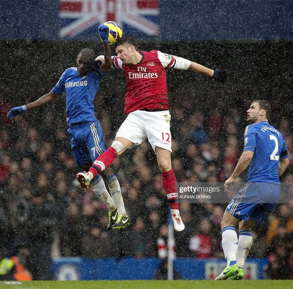 "Chelsea's Brazilian midfielder Ramires (L) jumps for a header against Arsenal's French striker Olivier Giroud (C) during the English Premier League football match between Chelsea and Arsenal at Stamford Bridge in London on January 20, 2013. Chelsea won the game 2-1. USE. No use with unauthorized audio, video, data, fixture lists, club/league logos or ""live"" services. Online in-match use limited to 45 images, no video emulation. No use in betting, games or single club/league/player publications."