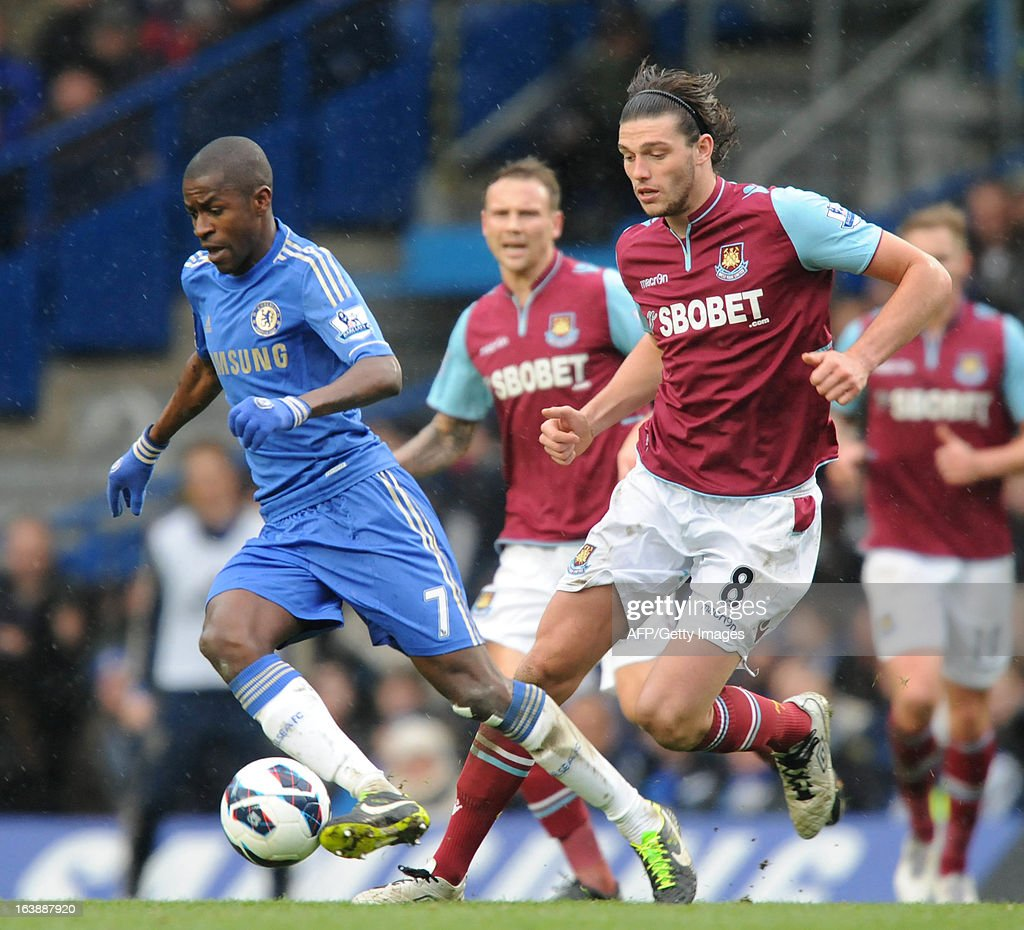 """Chelsea's Brazilian midfielder Ramires (L) vies with West Ham United's English striker Andy Carroll (R) during the English Premier League football match between Chelsea and West Ham United at Stamford Bridge in London on March 17, 2013. USE. No use with unauthorized audio, video, data, fixture lists, club/league logos or """"live"""" services. Online in-match use limited to 45 images, no video emulation. No use in betting, games or single club/league/player publications."""
