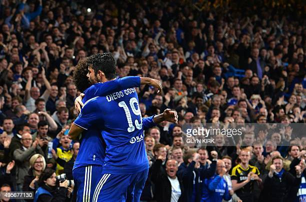 Chelsea's Brazilian midfielder Willian celebrates with Chelsea's Brazilianborn Spanish striker Diego Costa after scoring from a free kick during a...