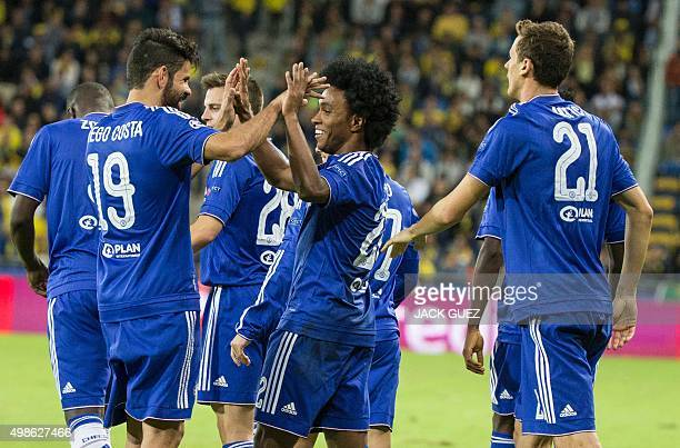 Chelsea's Brazilian midfielder Willian celebrates with his teammates after scoring a goal during their UEFA Champions League group G football match...