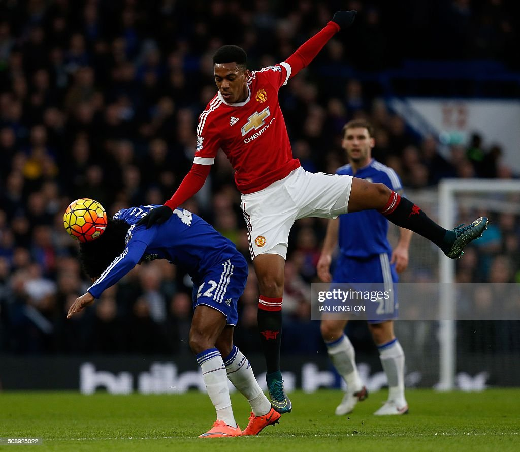TOPSHOT - Chelsea's Brazilian midfielder Willian (L) climbs for a header with Manchester United's French striker Anthony Martial during the English Premier League football match between Chelsea and Manchester United at Stamford Bridge in London on February 7, 2016. / AFP / Ian Kington / RESTRICTED TO EDITORIAL USE. No use with unauthorized audio, video, data, fixture lists, club/league logos or 'live' services. Online in-match use limited to 75 images, no video emulation. No use in betting, games or single club/league/player publications. /