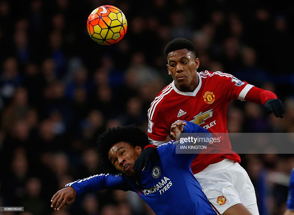 Chelsea's Brazilian midfielder Willian (L) climbs for a header with Manchester United's French striker Anthony Martial during the English Premier League football match between Chelsea and Manchester United at Stamford Bridge in London on February 7, 2016. / AFP / Ian Kington / RESTRICTED TO EDITORIAL USE. No use with unauthorized audio, video, data, fixture lists, club/league logos or 'live' services. Online in-match use limited to 75 images, no video emulation. No use in betting, games or single club/league/player publications. /