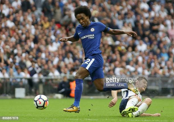 Chelsea's Brazilian midfielder Willian controls the ball during the English Premier League football match between Tottenham Hotspur and Chelsea at...