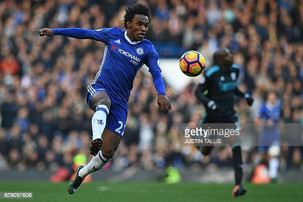 Chelsea's Brazilian midfielder Willian runs with the ball during the English Premier League football match between Chelsea and West Bromwich Albion...
