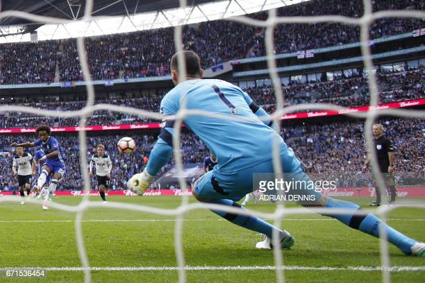 Chelsea's Brazilian midfielder Willian scores a penalty past Tottenham Hotspur's French goalkeeper Hugo Lloris during the FA Cup semifinal football...