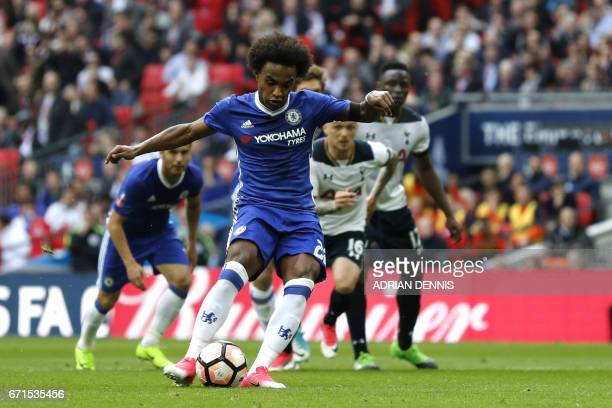 Chelsea's Brazilian midfielder Willian scores during the FA Cup semifinal football match between Tottenham Hotspur and Chelsea at Wembley stadium in...