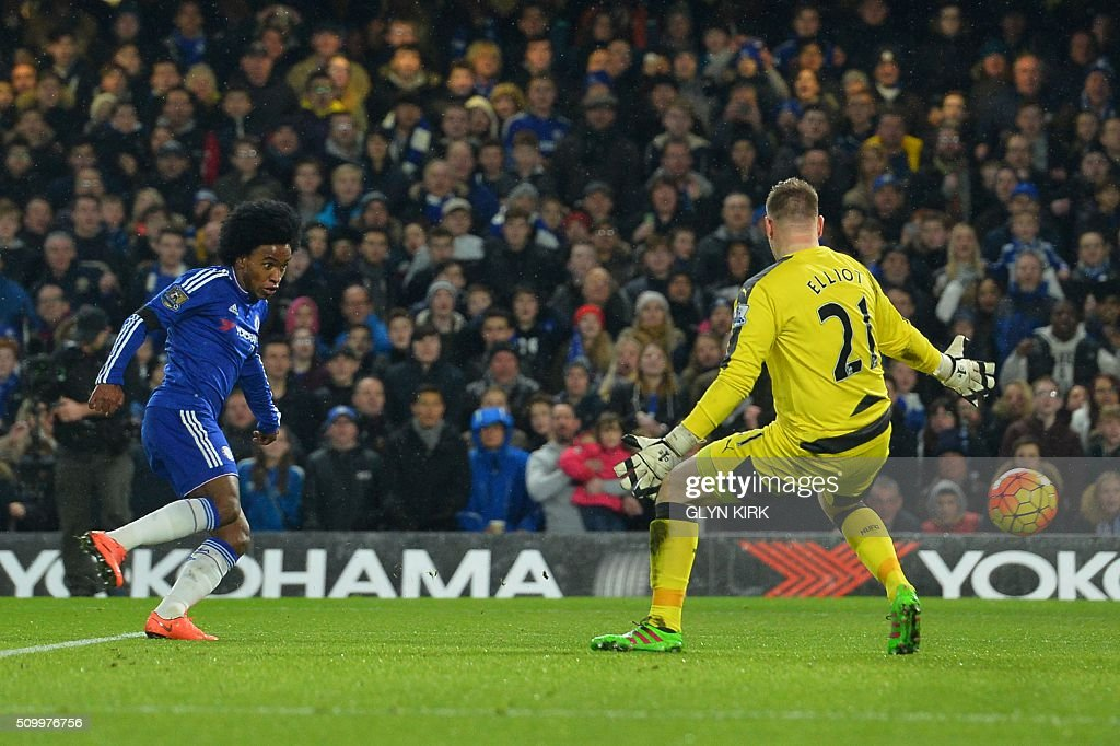 Chelsea's Brazilian midfielder Willian (L) scores his team's thrid goal past Newcastle United's English-born Irish goalkeeper Rob Elliot during the English Premier League football match between Chelsea and Newcastle United at Stamford Bridge in London on February 13, 2016. / AFP / GLYN KIRK / RESTRICTED TO EDITORIAL USE. No use with unauthorized audio, video, data, fixture lists, club/league logos or 'live' services. Online in-match use limited to 75 images, no video emulation. No use in betting, games or single club/league/player publications. /