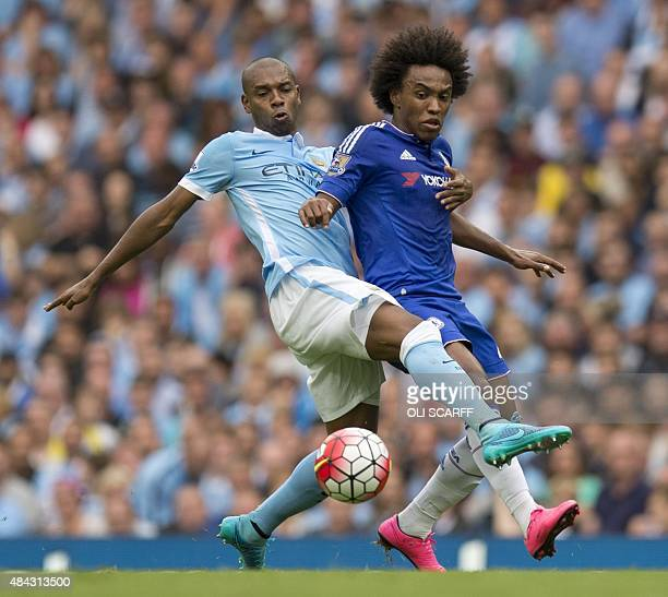 Chelsea's Brazilian midfielder Willian vies for the ball with Manchester City's Brazilian midfielder Fernandinho during the English Premier League...