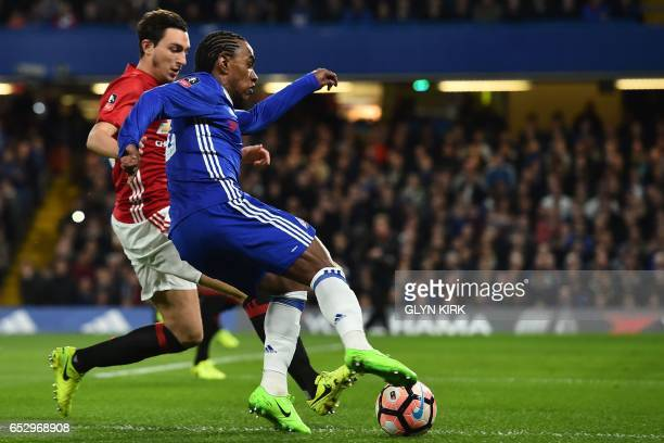 Chelsea's Brazilian midfielder Willian vies with Manchester United's Italian defender Matteo Darmian during the English FA Cup quarter final football...