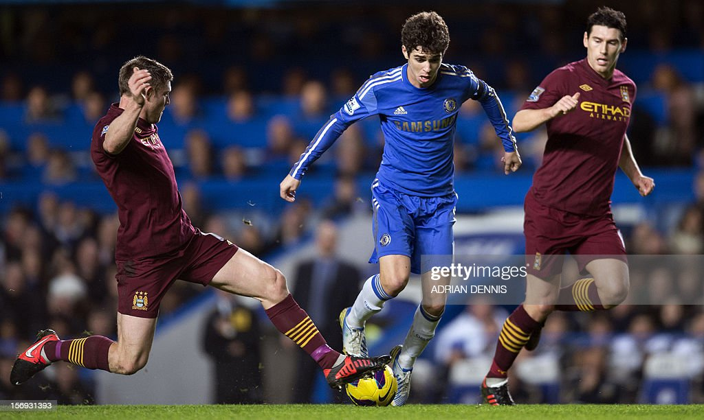 "Chelsea's Brazilian player Oscar (C) vies for the ball against Manchester City's James Milner (L) and Gareth Barry (R) during the English Premier League football match between Chelsea and Manchester City at Stamford Bridge in London on November 25, 2012. USE. No use with unauthorized audio, video, data, fixture lists, club/league logos or ""live"" services. Online in-match use limited to 45 images, no video emulation. No use in betting, games or single club/league/player publications"