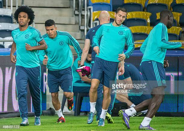 Chelsea's Brazilian players Wilian and Kenedy Belgian midfielder Eden Hazard and French defender Kurt Zouma take part in a training session at the...