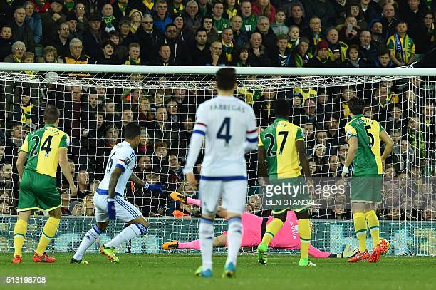 Chelsea's Brazilian striker Kenedy scores the opening goal in the first minute of the English Premier League football match between Norwich City and...