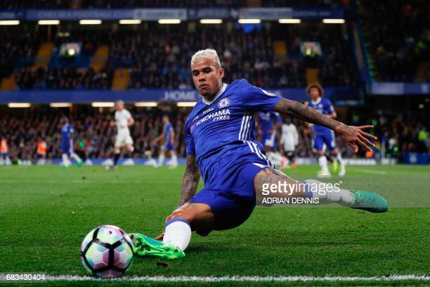 Chelsea's Brazilian striker Kenedy tries but fails to keep a ball in play during the English Premier League football match between Chelsea and...